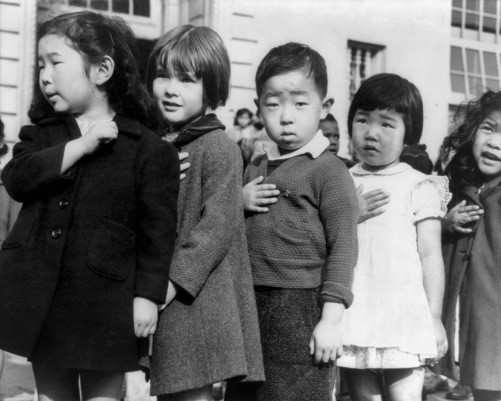 First graders, some of Japanese ancestry pledging allegiance to the American flag in 1942, shortly before the internment of Japanese Americans.