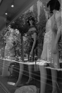 This photographic composition uses 'natural' features of the urban landscape in order to create an optical illusion where the reflected image in the window overlays the mannequins. Our perception of what is considered real and is altered.