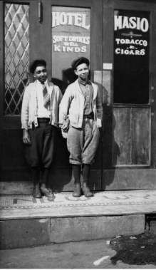 Charles Teenie Harris, two boys outside the Masio Hotel, Hill District