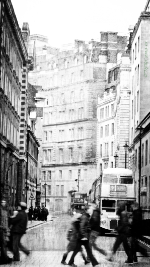 Despite being captured in 2013, this London street scene has been enhanced so that it looks like an old faded lithograph. The style of the old fashioned double decker busses adds to the ambiguity of the age of the image, as does the lack of definition of the people crossing the street, as well as the lack of focal sharpness of the overall shot. The image sharpness and quality of the shot, including the ambiguity of the age of the shot adds to its artfulness, despite being a straightforward representation of a real and modern street scene.