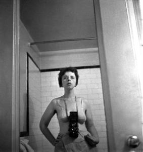 Lisette Model, self-portrait, Manhattan, ca. 1940. Some have cited this, and other shots as evidence that Model's work also influenced Vivian Maier.