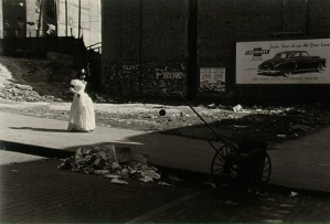 Roy DeCarava, Perhaps his most famous image: a girl walks along a Harlem street in her graduation dress.